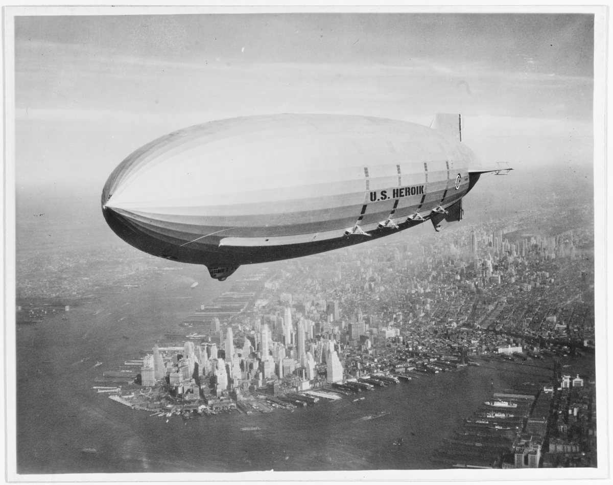 Off the California coast lies the sunken wreckage of the U.S. Navy's last flying aircraft carrier -- USS Macon (ZRS-5). The Macon served as a launch and takeoff platform for biplanes. FILE -- Flying over New York Harbor, circa Summer 1933. The southern end of Manhattan Island is visible in the lower left center. U.S. Naval History and Heritage Command Photograph.
